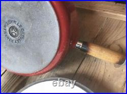 Le Creuset Set If 4 Red Cerise Cast Iron Pans And A Heavy Cast Black Pan Stand